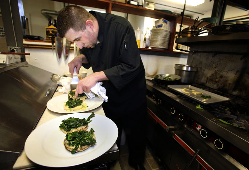 """Paul Dyer, executive chef at the Porthole, prepares eggs Florentine, which is """"probably our number one-selling dish right now on our menu,"""" he said."""
