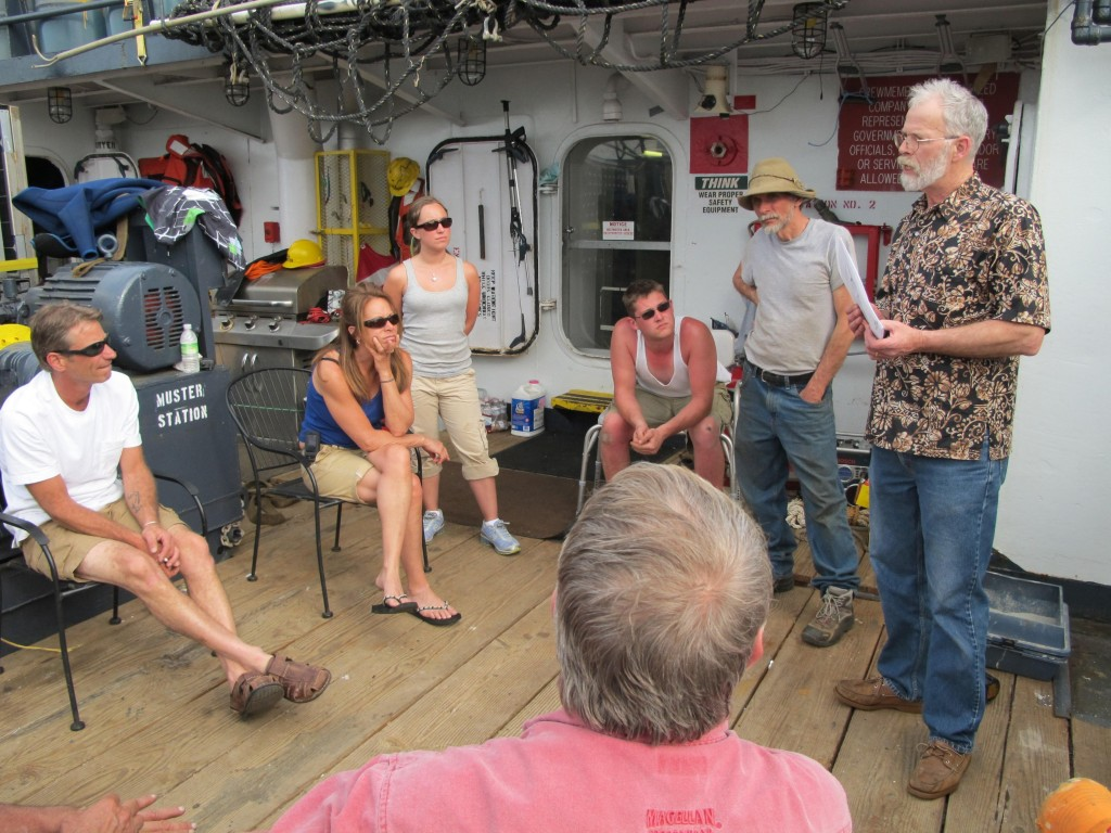 Shipmaster Kevin Garthwaite of Wells speaks with crew members Sunday aboard the Sea Hunter. A final Coast Guard safety inspection is expected this morning.