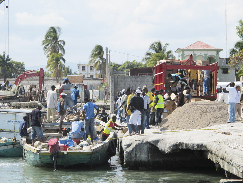 Haitian workers at the dock in Les Cayes transfer relief supplies Friday from Sea Hunter onto a truck for transport to Hope Village, an orphanage and community assistance program operated by the Rev. Marc Boisvert, a native of Lewiston.