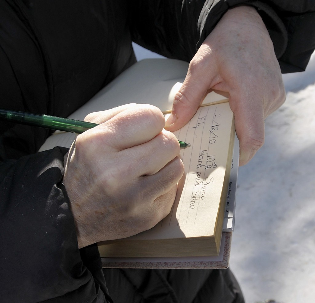 Miriam Gibely of Sweden records clues to an animal track found in the Holt Preserve during a Lakes Environmental Association seminar last month. LEA has another animal tracking seminar scheduled for this month, at 7 p.m. March 19 in Bridgton.