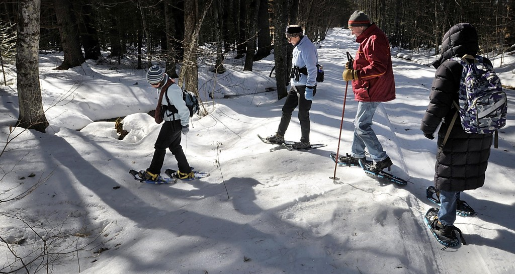 Bridie McGreavy leads a group into the Holt Preserve to identify animal tracks. From left are McGreavy, Leigh Hayes of Bridgton, Derby Cartmill of Casco and Miriam Gibely of Sweden.