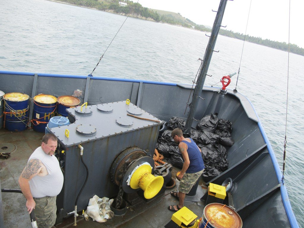 Chief engineer Brian Ryder of West Bath, left, and volunteer Rick Woodbury of Scarborough set the Sea Hunter's anchor Tuesday off the Haitian port of Les Cayes.