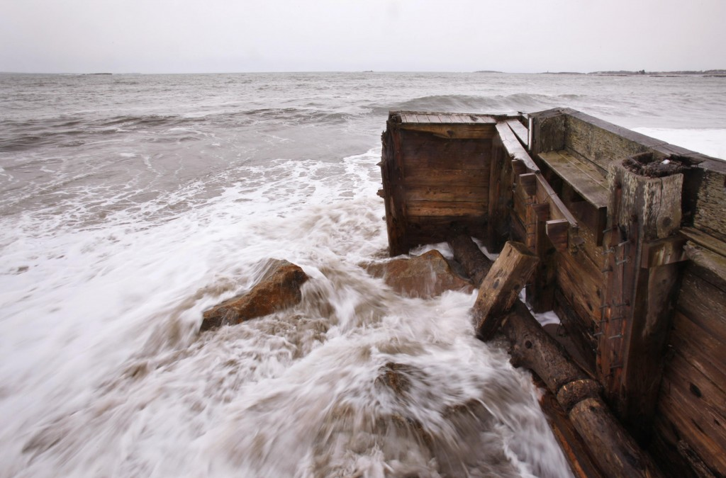 Waves pound the seawall at Camp Ellis in Saco Thursday. The front section was taken out during the Patriots Day storm.