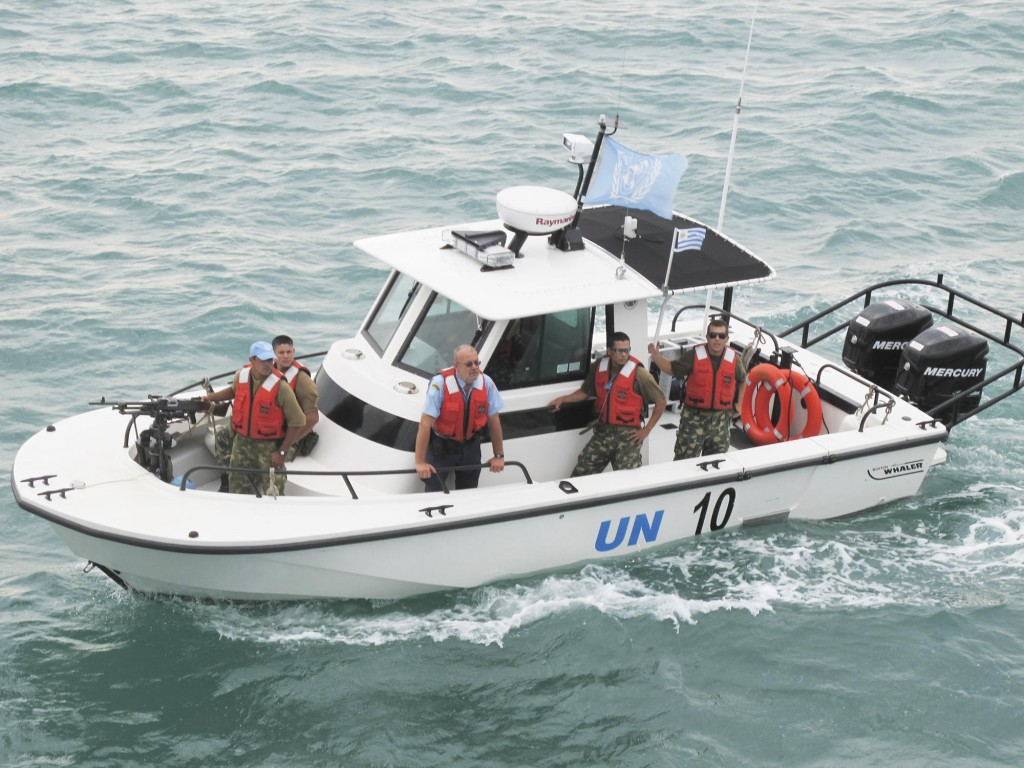 A United Nations Police patrol boat arrives at Sea Hunter's anchorage Friday morning to provide security during the offloading operations off the coast of Les Cayes, Haiti.