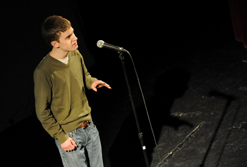 """Aaron Bartlett, a senior at Gorham High School, performs """"La Figlia che Piange"""" by T.S. Eliot during the first of three rounds at the Poetry Out Loud state finals Friday evening at the Waterville Opera House. Champion Will Whitham, a Bangor High senior, will go to Washington D.C. for the national finals in April."""