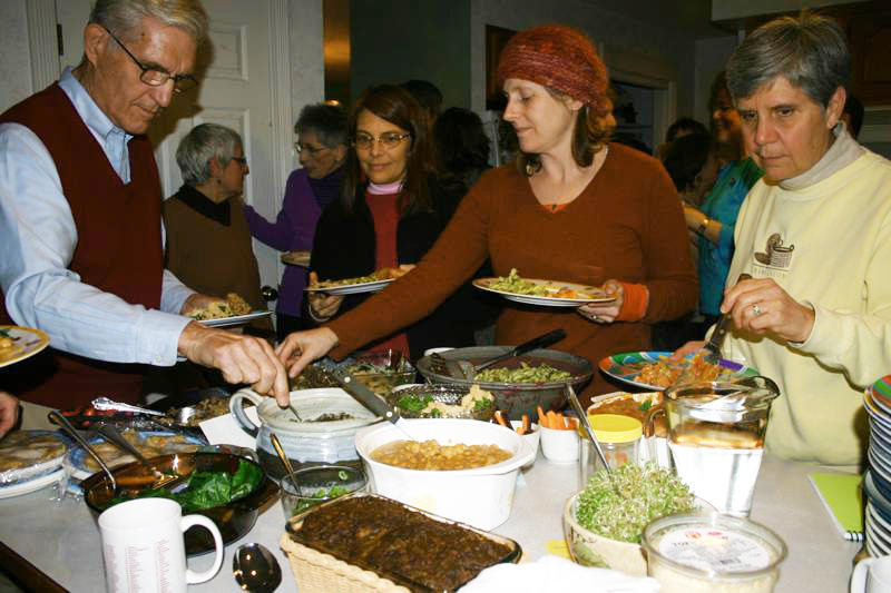Phil Coupe, Karen Wildwood, Lisa Silverman and Carol Landry help themselves to the delicious whole foods at this month's macrobiotic potluck.