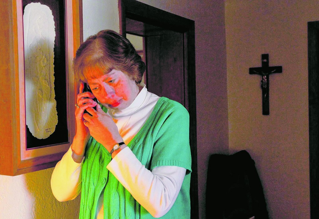 """""""My annulment gave me a chance to heal,"""" said Mary Beth Erickson, seen at home in Oakville, Mo., who now is an annulment advocate for couples going through the process."""