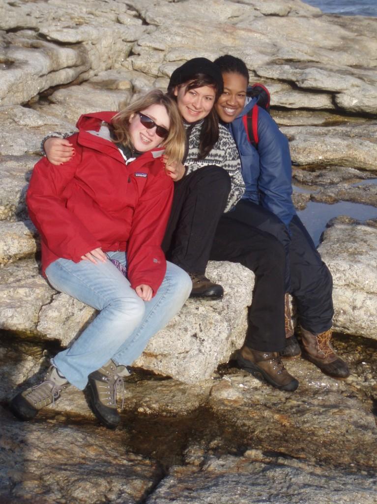 Margaret Keefe of Camden, Christine Munoz, Ingelwood, Calif., and Frankline Mardi of Boston share a bonding moment at Popham Beach after studying beach erosion.