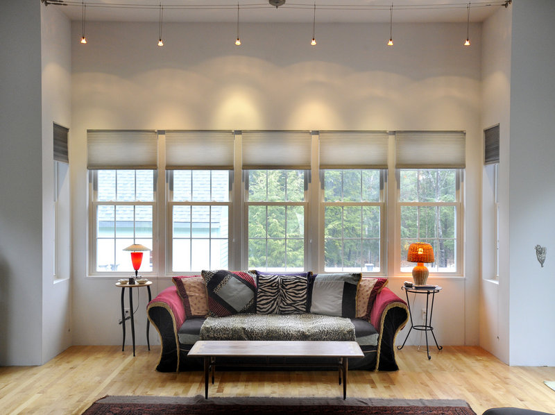 An attractive sitting area is awash in light thanks to a bank of windows.
