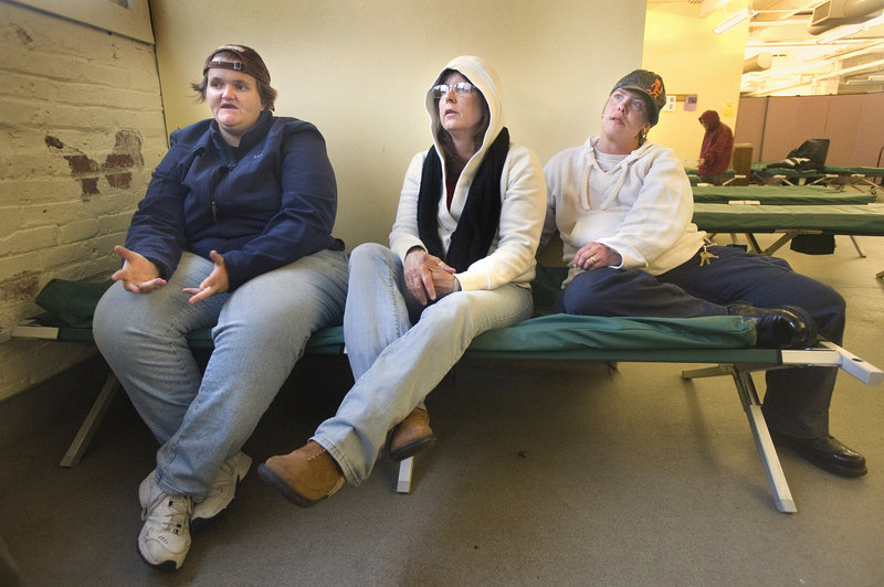 Women who have been staying at the Preble Street shelter are looking forward to this week's move to Florence House. They say they are most excited about having a bed and a place to leave their belongings. From left are Shellie Duncan, Brenda Biggs and Kaylah Stowell.