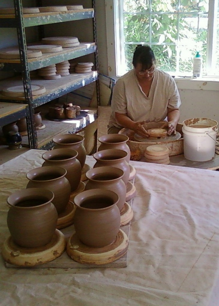 Beatrice Gilbert of North Yarmouth works on pots in her studio. She is one of 15 potters who sell wares at Maine Potters Market in Portland's Old Port.