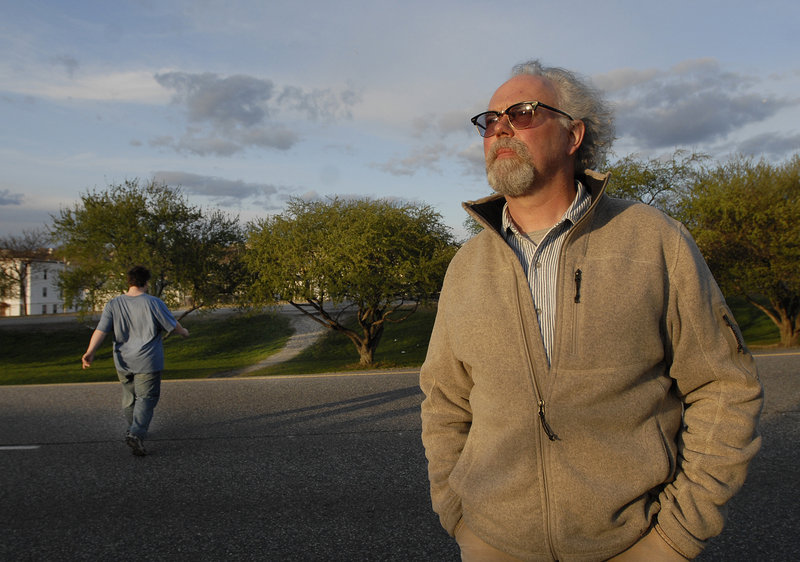 """Jay York of Portland, who routinely uses his iPhone camera to document the hazards of jaywalking, stands along Franklin Arterial on Monday. """"It is so blatantly obvious how dangerous these crossings are,"""" he said."""