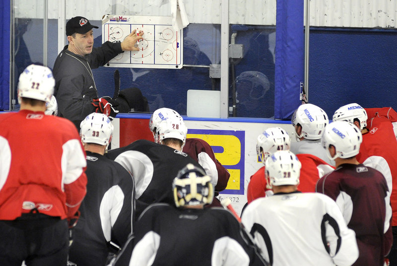 Coach Kevin Dineen goes over plays during the Pirates' practice Wednesday. Portland opens a best-of-seven playoff series against Manchester on Friday at the Civic Center.