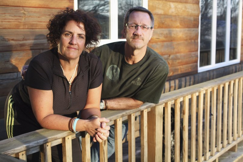 P.K. and Tom Harrison stand on the balcony of their home in Boon, Mich. The Harrisons have been on a campaign to prevent bullying since the suicide of their 16-year-old son Alex Harrison, who died in February 2009. A Michigan State Police investigation determined that Alex had been harassed by his peers at Cadillac High School before his death.
