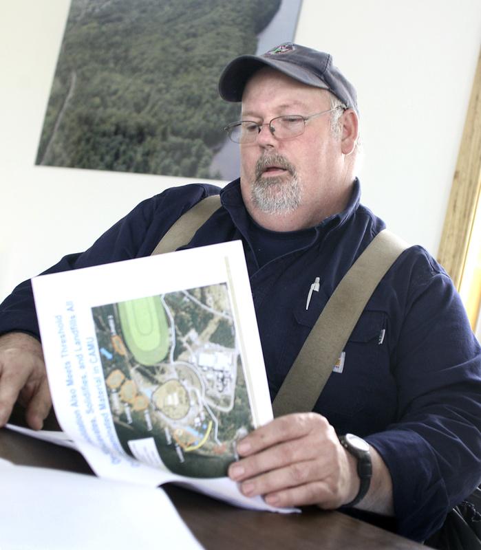 Selectman Howard Grover backs a company plan to remove one of five mercury-laden landfills.
