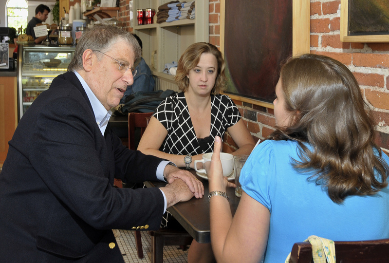 Independent Eliot Cutler talks recently at Arabica Coffee on Free Street in Portland with customers Hannah Payeur of South Portland, left, and Cassandra Grantham of Portland.