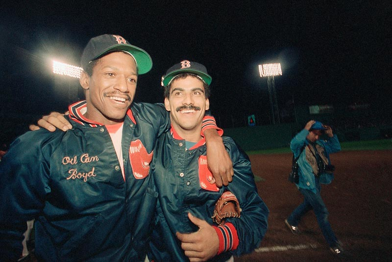 """Dennis """"Oil Can"""" Boyd, left, with a teammate, Ed Romero, was the toast of Boston in 1985 and '86 when he totaled 31 wins for the Red Sox and helped them to the World Series in 1986. He never reached those peaks again, but remains a crusader for baseball and independent league teams that promise a chance."""