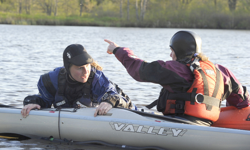 Outdoor writer Shannon Bryan gets a kayak lesson from Theresa Ouellette of Coastal Maine Kayak on the water at Highland Lake in Falmouth.