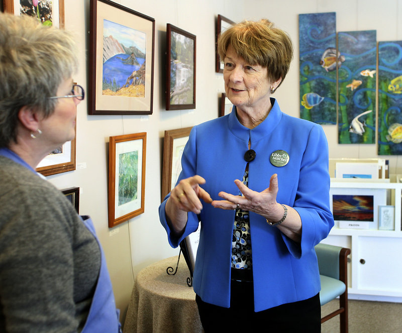 Libby Mitchell visits with artist Susan Mesick on Tuesday at a gallery in downtown Sanford while campaigning for governor.