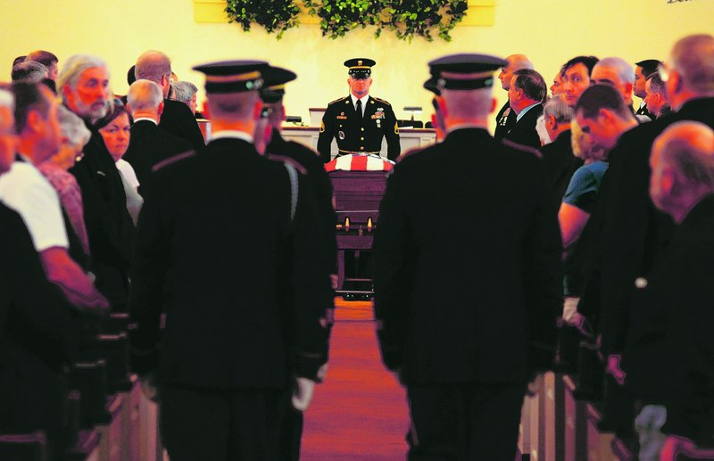 A Maine Army National Guard honor guard detail prepares to carry the casket with the remains of Army Spc. Wade Slack out of the Blessed Hope Advent Christian Church in Waterville at the conclusion of his funeral Sunday.