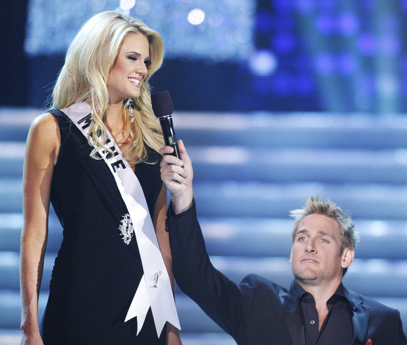 """Miss Maine, Katherine Ashley """"Katie"""" Whittier of New Gloucester, is teased about her height by host Curtis Stone during the Miss USA 2010 pageant on Sunday in Las Vegas."""
