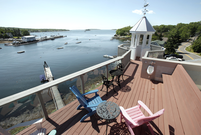 The views from the top deck of the Oest home, overlooking Boothbay Harbor, are nothing short of spectacular.