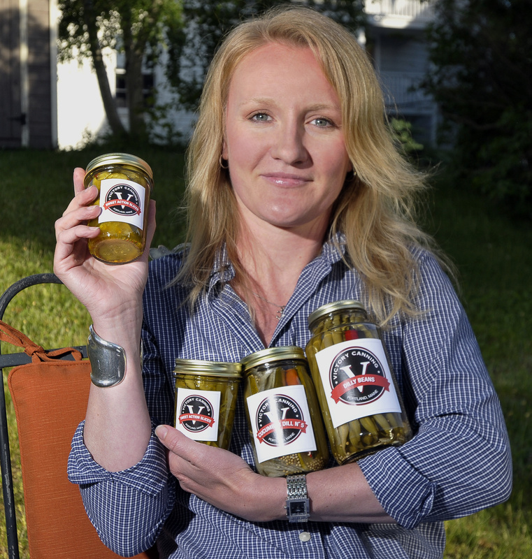 "Fayth Preyer of Portland displays her Victory Canning pickles. She learned the importance of a business plan during a five-week ""From Recipe to Market"" course offered by the University of Maine Cooperative Extension."