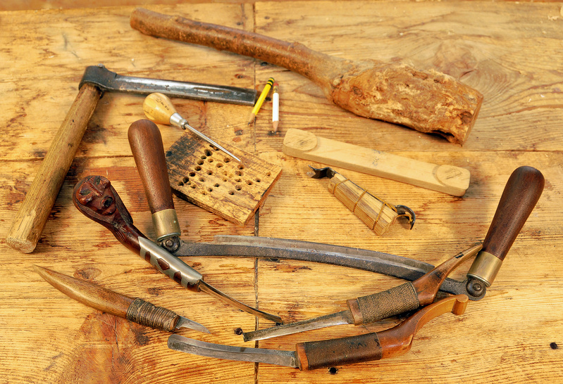 Steve Cayard's hand tools, include a froe, left, for splitting the cedar using a maul, top, and a variety of draw and crooked knifes.