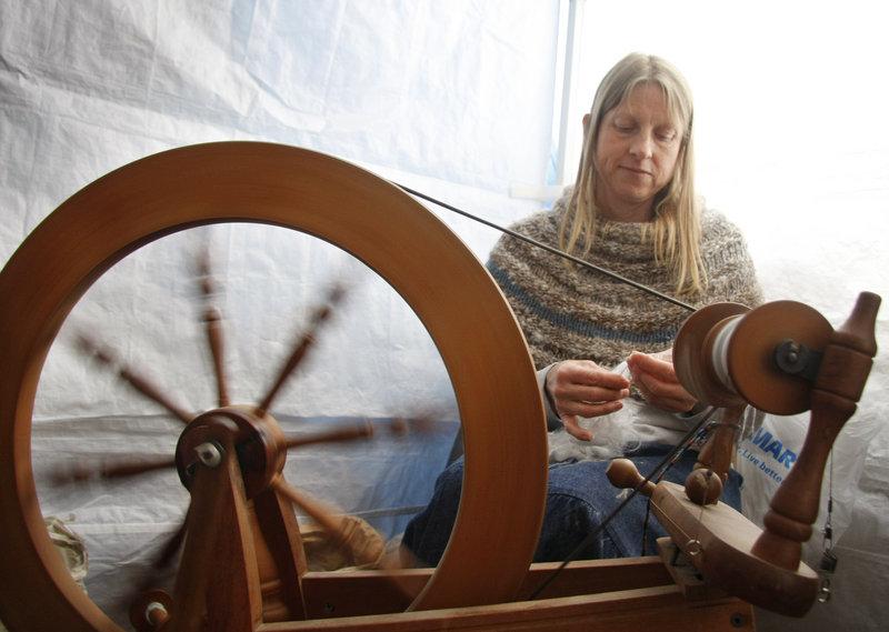 Karen Cornell of CrowsRise Farm in Anson spins English Angora wool.