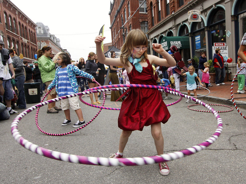 Ruby Day, 7, of Portland has some fun with hula hoops provided by Hoopalula!.