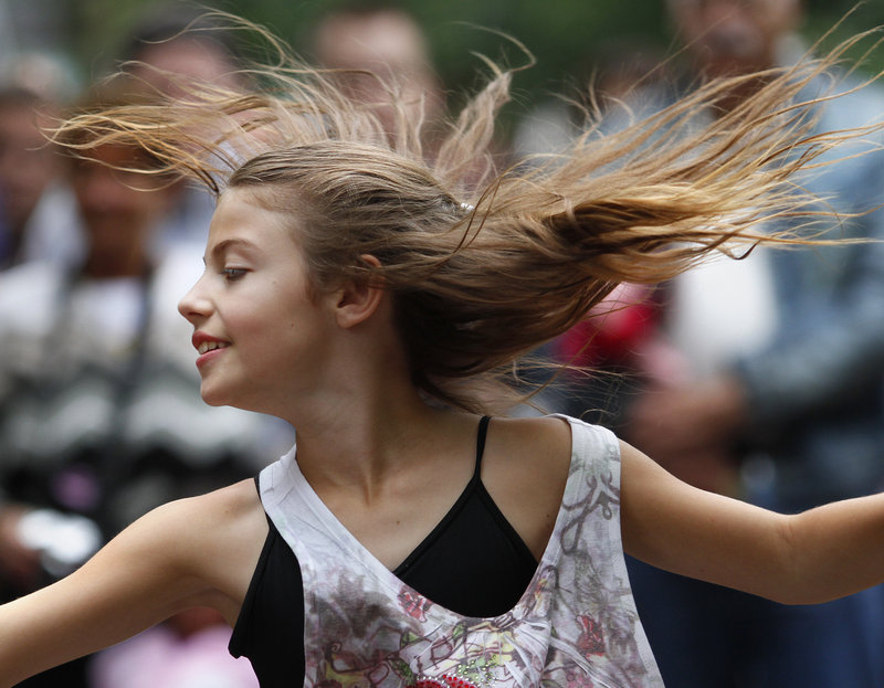 Kayleigh Bowen, 10, of Gray spins while performing with the Pulse Dance Company.