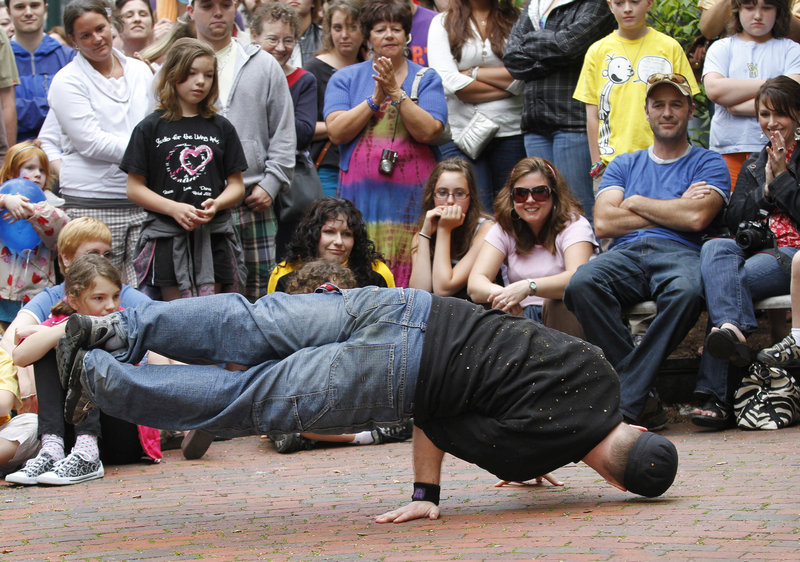 Bruce Tracy break dances in Post Office Park in Portland during a dance competition at the Old Port Festival on Sunday.