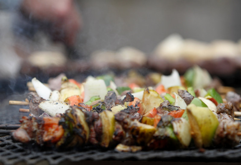 Lamb kabobs from the Noon Family Sheep Farm in Springvale cook on the grill.