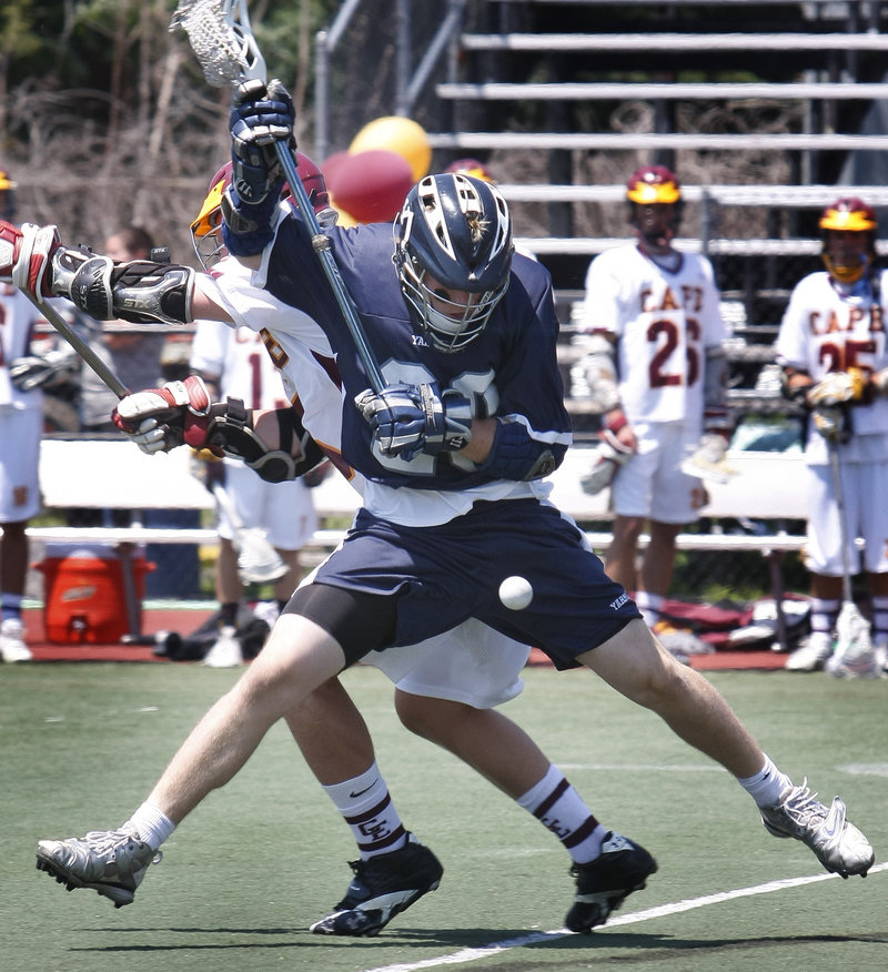 David Dietz of Yarmouth tries to keep control of the ball Saturday while pressured by Timmy Takach of Cape Elizabeth during Cape's 7-6 win in the Class B state final at Fitzpatrick Stadium.