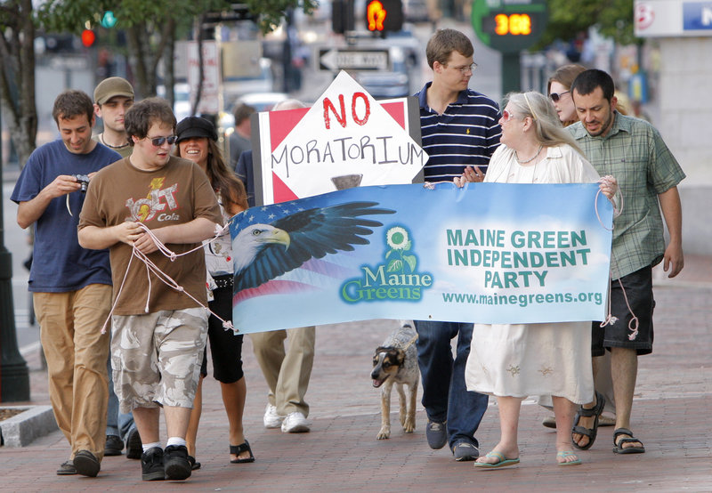 Demonstrators opposing a proposed moratorium on medical marijuana dispensaries in Portland march down Congress Street to Portland City Hall on Monday. Critics urged councilors not to stand in the way of helping patients who need access to the drug.