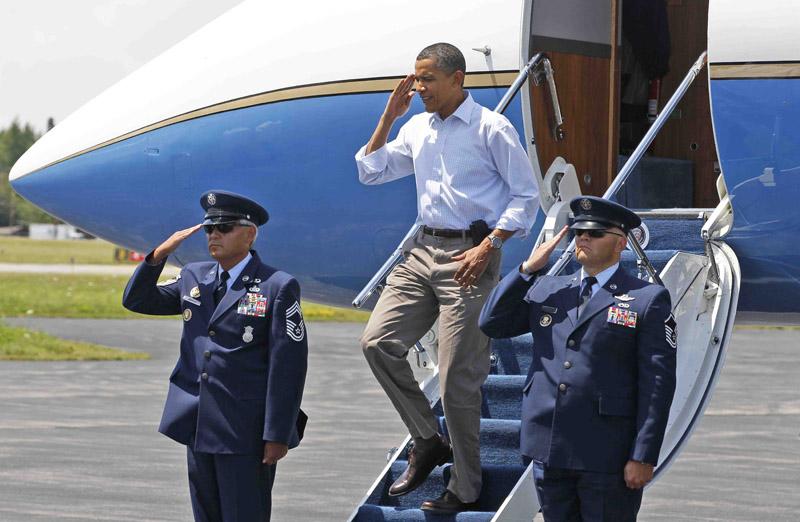 President Barack Obama salutes upon his arrival in Trenton.