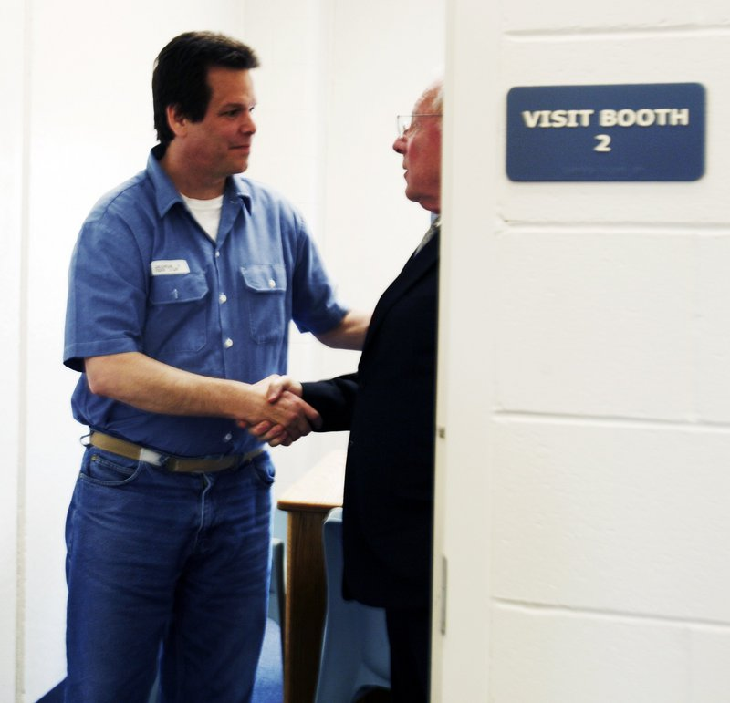 "Inmate Dennis Dechaine shakes hands with attorney F. Lee Bailey, right, after a meeting at the Maine State Prison in Warren on April 8, 2009. ""All that I promised to do, and have done, is to use past friendships and associations to get Dennis what he couldn't afford,"" Bailey said. ""I don't wish to be an advocate for anybody."""