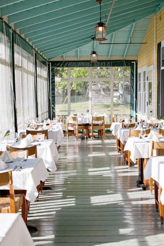The Chebeague Island Inn's porch makes an enjoyable dinner setting. An improved menu, under the direction of a new chef, has made the inn a popular destination this summer.