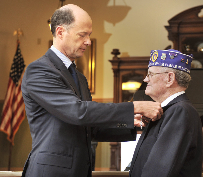 Elvert Pooler receives the Legion of Honor medal Wednesday from Christophe Guilhou, consul general of France in Boston, at the Sanford Springvale Historical Museum.