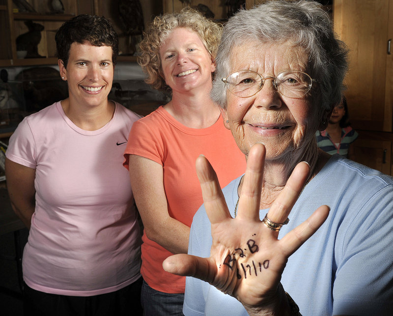 Della Hitchcox, 80, marked her palm as a reminder of this year's Beach to Beacon 10K Road Race, which she plans to run with her two daughters, Jennifer Hitchcox, left, and Susan Gallo.