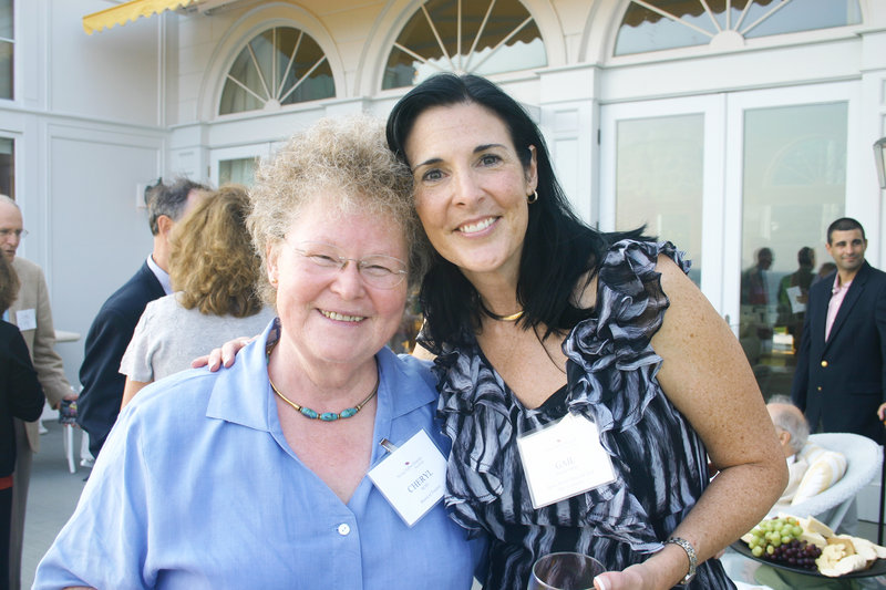 Cheryl Rust, Spring Harbor trustee, and Gail Wilkerson, host committee member.
