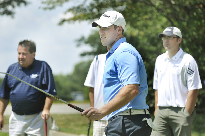 Jimmy Howard, a former Maine goalie who now plays for the Detroit Red Wings, watches a putt head toward the hole Monday during the Shawn Walsh Memorial Golf Tournament at Sable Oaks Golf Course.