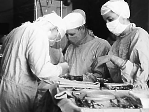 The Associated Press Dr. William Mac Vane, center, assists Dr. Emerson Drake with the first open heart surgery at Maine General Hospital in 1959.