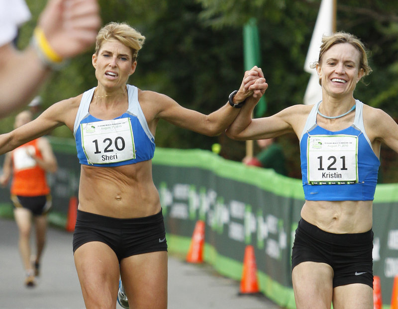 Sheri Piers, left, and Kristin Barry reach the finish line together. Officials named Barry the winner of the Maine women's division.
