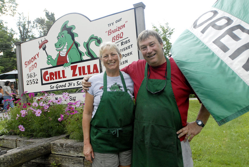 Sarah Burnham and Jay Swett, owners of Grill Zilla BBQ in Damariscotta, are accused of trademark infringement by Godzilla's lawyers.