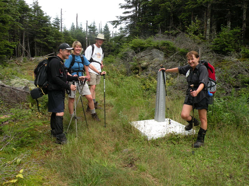 Three hikers in Quebec and one in the United States.