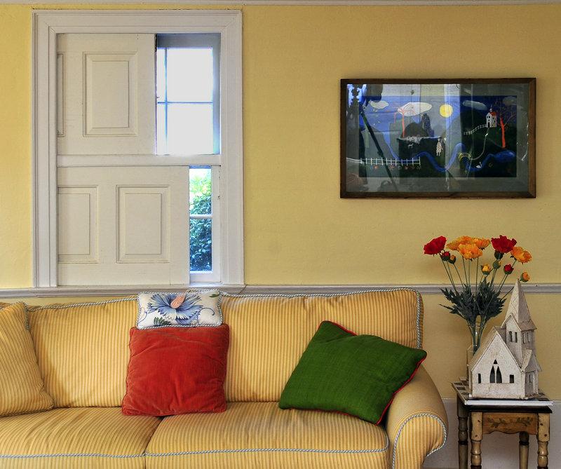Pocket shutters on the living room windows slide open and shut.