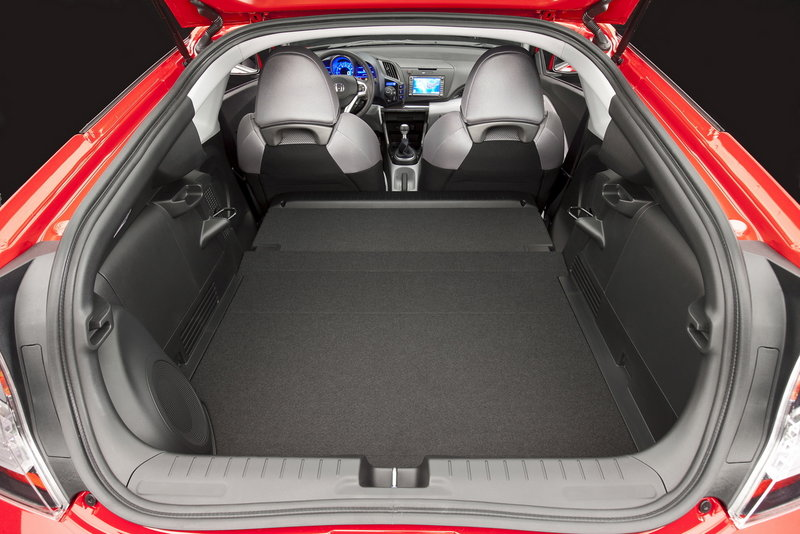 Cargo space is less roomy than the Honda CR-Z's thick rear quarters and hatchback design suggest, but it has a couple of useful cubbies behind the front seats.