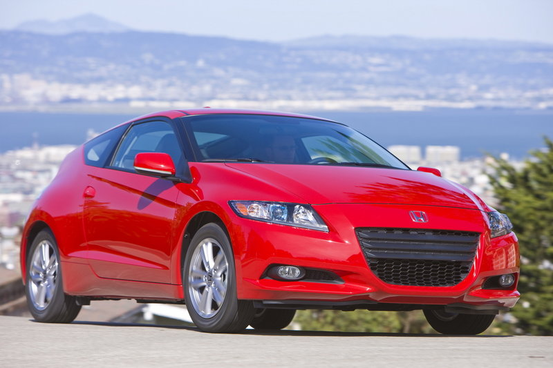 """Honda calls the 2011 CR-Z's distinctive styling a """"one-motion wedge."""" Despite its uniqueness, it evokes memories of the original Insight hybrid and the sporty CRX coupes of the mid-1980s to 1990s. Its cockpit, however, looks more like a command console from Star Trek."""