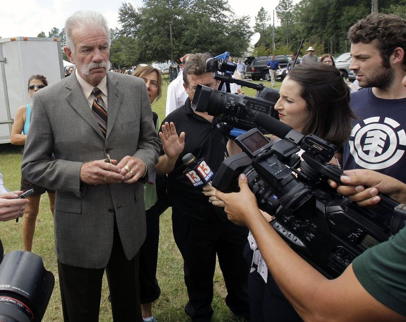 Pastor Terry Jones of the Dove World Outreach Center answers questions after a news conference in Gainesville, Fla., Wednesday. Jones said he is going forward with a plan to burn copies of the Quran.